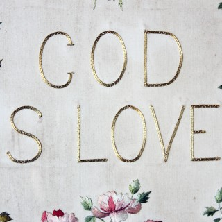 An Edwardian Gilt-Framed & Heart-Shaped Verre Eglomisé Needlework Panel; 'God is Love' c.1902