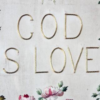 An Edwardian Gilt-Framed & Heart-Shaped Verre Eglomisé Needlework Panel; 'God is Love' c.1902