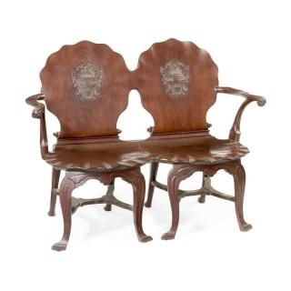 An Irish George III mahogany double chairback hall settee
