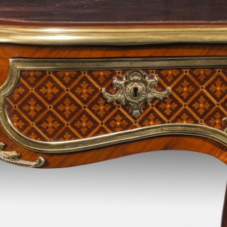 A fine kingwood and marquetry bureau plat in the French taste.