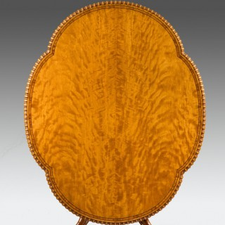 A Gillow satinwood centre table