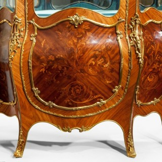 A pair of exhibition quality Napoleon III kingwood vitrines, decorated with floral marquetry, with ormolu mounts.