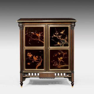 An exquisite exhibition quality side cabinet by Giroux, with central doors bearing lacquer panels showing the four seasons.