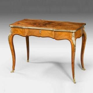 A fine mid Victorian burr walnut writing table