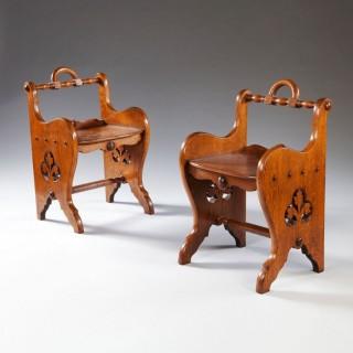 A pair of Oak Arts and Crafts stools