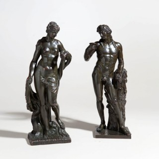 A pair of Louis XIV bronze figures of Bacchus and Amphitrite