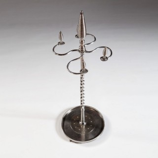 A Highly Unusual Polished and Cut Steel Fire Iron Stand
