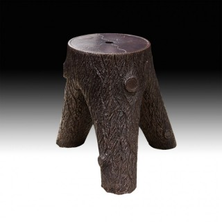 A Tree Stump Stoneware Stool