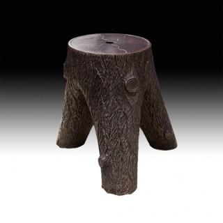 A Tree Stump Stoneware Stool