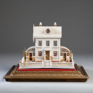 An Edwardian white painted model ideal cottage