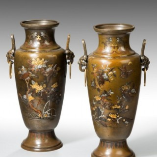 A large pair of mixed metal Meiji Period vases