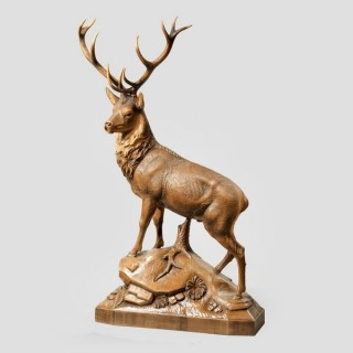 A superb quality 'Black Forest' maple wood model of a stag signed by F R Michel of Bonigen, Switzerland.