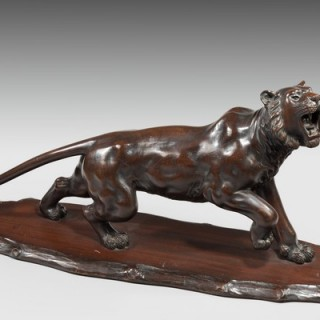 A Meiji period carved wooden tiger