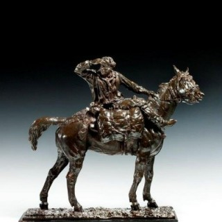 This fine bronze sculpture shows a mounted Cossack shading his eyes as he turns to scan the horizon.