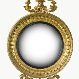 Large Regency giltwood convex mirror.