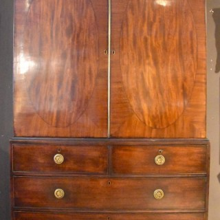 An Elegant George III Mahogany Oval Panelled Linen Press