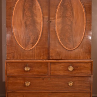A Very Fine Quality George III Mahogany Oval Panelled Linen Press