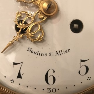 A Patinated and Gilt-Bronze Hanging Clock