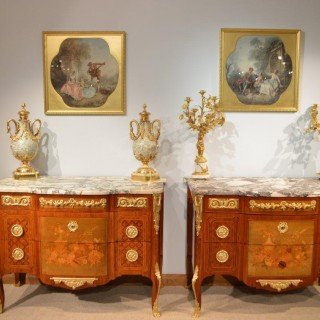 A magnificent pair of Louis XVI transitional style 19th Century French marble topped commodes after the original model by J.H. Riesener