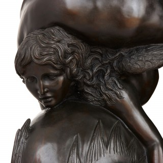 Bronze figurative sculpture of Amor with a dolphin