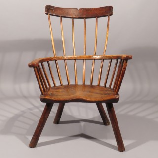 An 18th Century Primitive Ash and Elm Comb Back Windsor Chair