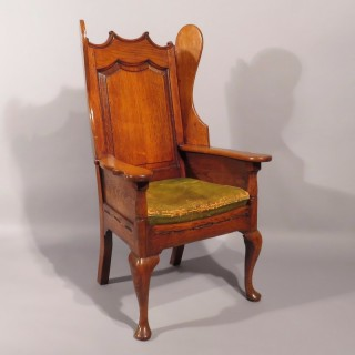 A George II Oak Wing Arm Chair
