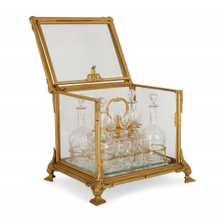 Antique French liqueur set in an ormolu and glass casket