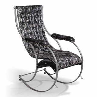 A steel and leather rocking chair in the manner of R.W Winfield