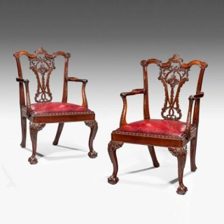 A fine pair of Victorian mahogany open armchairs in Chippendale taste