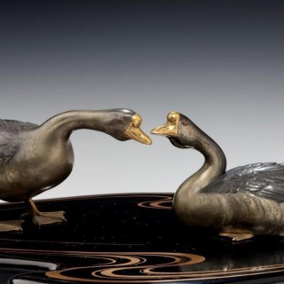 A fine Showa period okimono of two ducks on an original black lacquer stand with original box