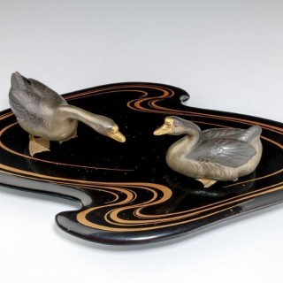 A fine Showa period okimono of two ducks on an original black lacquer stand with original box