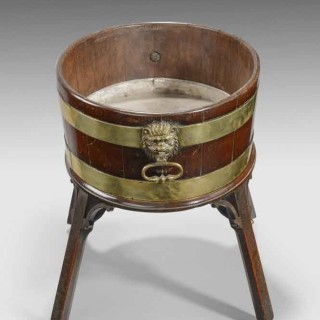 A fine mahogany and brass bound Georgian wine cooler.