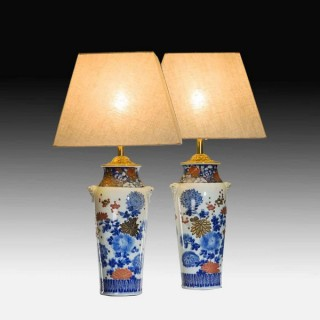 A pair of Meiji period Arita vases with overglaze polychrome and gilt chrysanthemums
