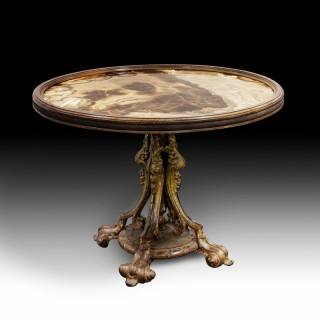 A  gilded cast Iron centre table with an onyx top.