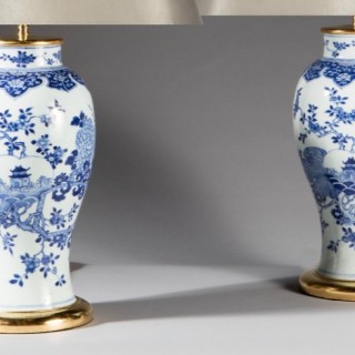 A pair of Chinese Blue and White vases as lamps