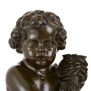 Pair of patinated bronze antique cherubs, after Clodion