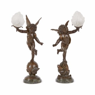 Pair of French antique bronze table lamps with cherubs