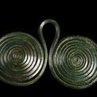 Bronze Age spectacle fastener of good size