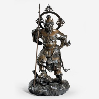 A powerful Japanese bronze Bishamonten quelling an Oni