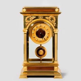 An unusual and superb quality rectangular four glass ormolu mantel clock
