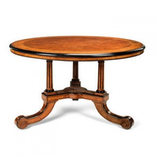 An early Victorian amboyna, burr walnut, ebonised, harewood and purplewood centre table