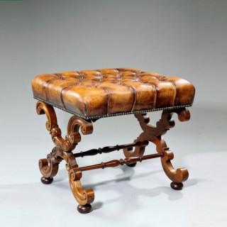 An early Victorian walnut x-frame stool