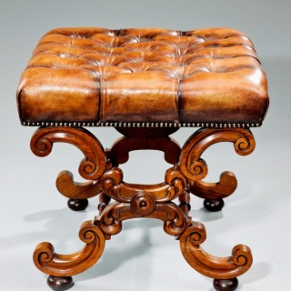 An early Victorian walnut x-frame stool
