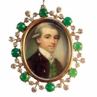 A fine portrait of a young Gentleman, set in the original gold frame with cabochon emeralds and diamonds