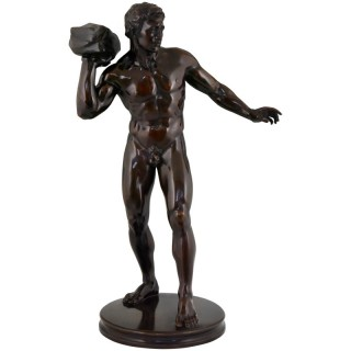 Antique sculpture of a male nude athlete