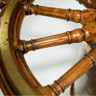 A very large table made from a late 18thC ship's steering wheel