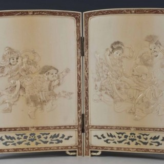 A DELIGHTFUL JAPANESE IVORY TWO FOLD TABLE SCREEN