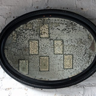 An Attractive Ebonised Victorian Oval Wall Mirror c.1870