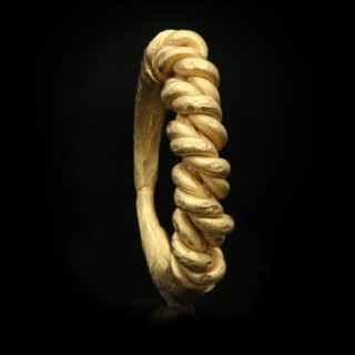 Viking twisted half hoop ring, circa 9th-11th century AD.