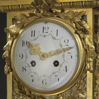 Gilt-Bronze Clock With A Marble Base
